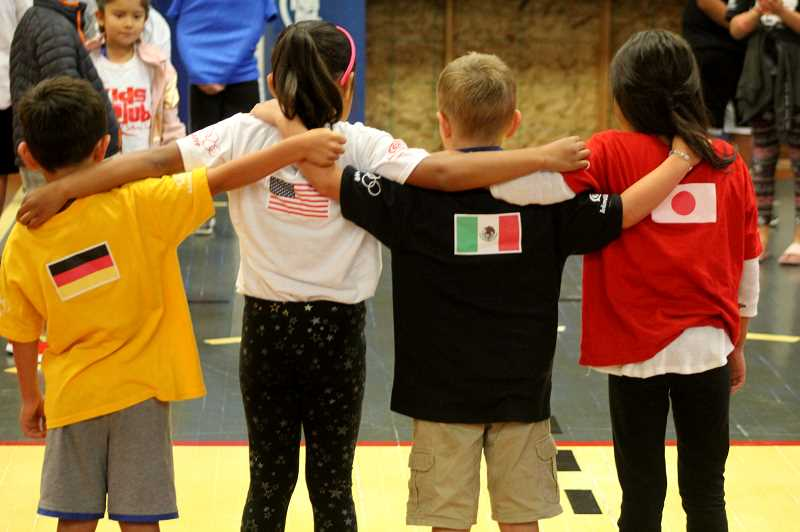 STEELE HAUGEN - Kids Club members from teams Germany, USA, Mexico, and Japan compete against each other during the 2019 Olympic program. The program lasted three weeks with kids competing in sports and country trivia.