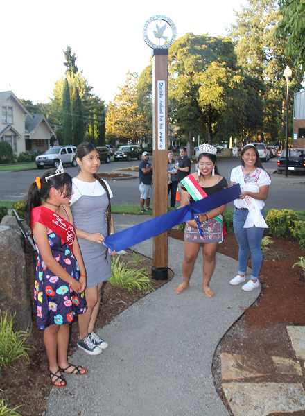 PMG PHOTO: JUSTIN MUCH - The 2019 Fiesta Mexicana court was onhand to help celebrate during the Woodburn City Council meeting/gala, which included ribbon cuttings at four completed projects: city hall renovation, peace pole and Library Park play equipment.
