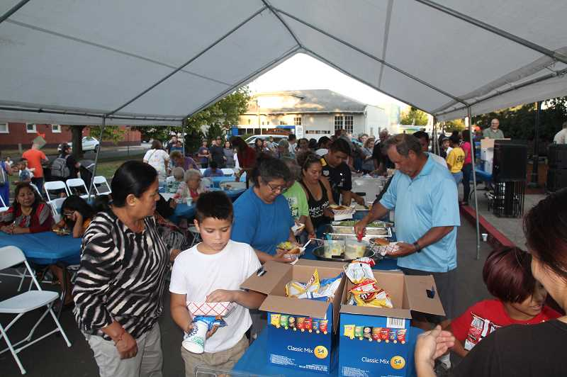 PMG PHOTO: JUSTIN MUCH - The barbecue was a popular draw at the Monday, Aug. 26, Woodburn City Council meeting/gala.
