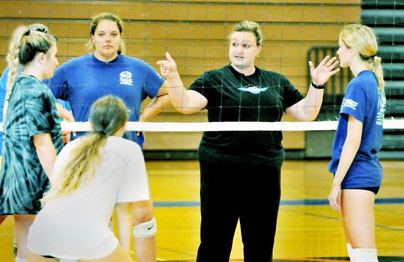 GRAPHIC PHOTO: GARY ALLEN - NHS coach Mackenzie Upchurch talks strategy with her players during a recent practice.