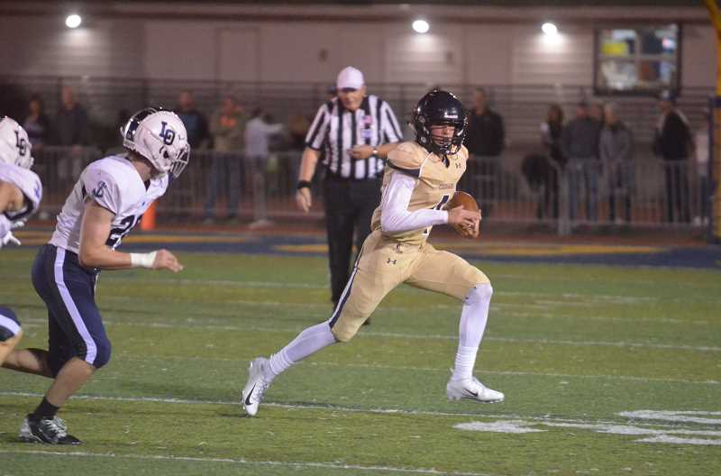 PMG FILE PHOTO - Canby then Quarterback Trent Wakefield runs the ball during the 2018 homecoming game versus Lake Oswego, when Canby scored two touchdowns.