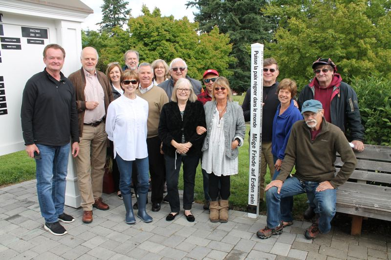 PMG FILE PHOTO - Members of the Oswego Pioneer Cemetery board and the Lake Oswego Rotary Club gather around a Peace Pole in Lake Oswego, similar to those found in Sherwood and other communities.