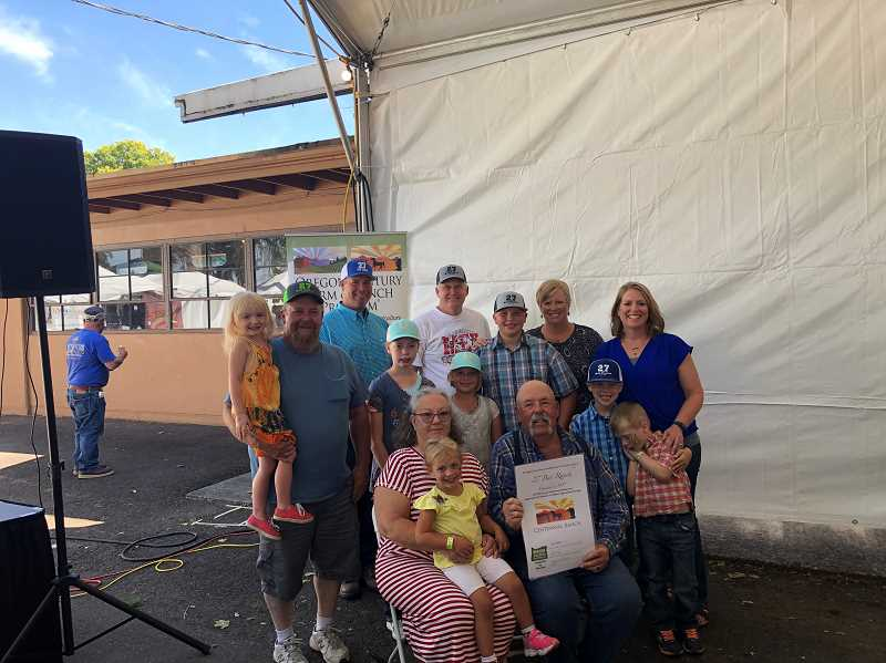 SUBMITTED PHOTO - The Nartz family, 14 members of it to be exact, gathered in Salem on Saturday to receive a certificate of Century Farm status for their family ranch in Ashwood.