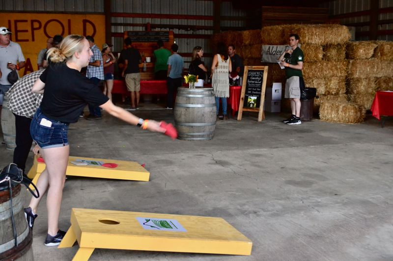 PMG PHOTO: BRITTANY ALLEN - Besides drinking, people had the opportunity to shop, listen to live music, enjoy dinner and/or play a variety of lawn games at the Boring Beer Fest Aug. 23-25.