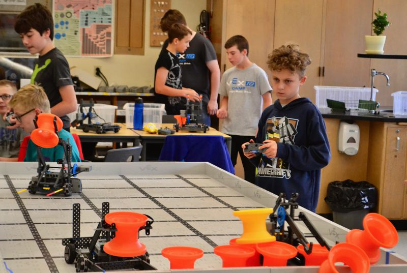 PMG PHOTO: BRITTANY ALLEN - CRMS teacher Dennis Lane sees robotics as not only a team-building activity, but a great way for kids to learn to create and not just use technology.