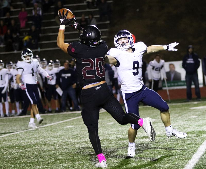 PMG FILE PHOTO: DAN BROOD - Lake Oswego's Casey Filkins (9), who was the TRL Offensive Player of the Year for the 2018 season, and Tualatin's John Miller (20), who shared the TRL Defensive Player of the Year honor, both return in 2019.