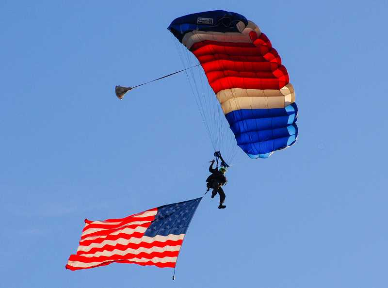 PHOTO BY TOM BROWN - David Jasper, of Skydive Awesome, flies an American flag as he prepares to land.