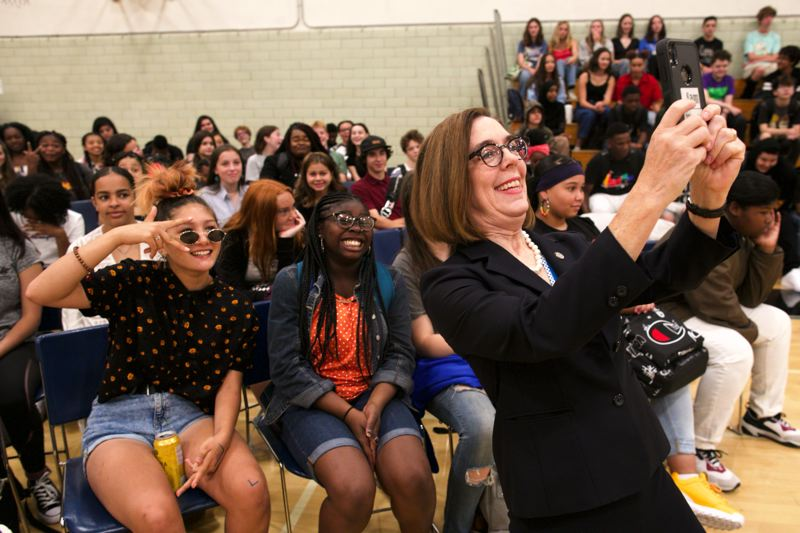 PMG PHOTO: JAIME VALDEZ - Gov. Kate Brown takes a selfie with Jefferson High School's incoming freshman class Wednesday morning, Aug. 28. The governor also ceremonially signed the state's new Student Success Act at the high school.