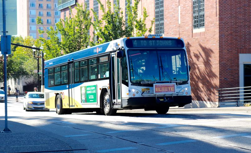 PMG PHOTO: ZANE SPARLING - A TriMet bus make an unimpeded stroll up Northwest Everett Street toward the Steel Bridge on Tuesday, Aug. 27.