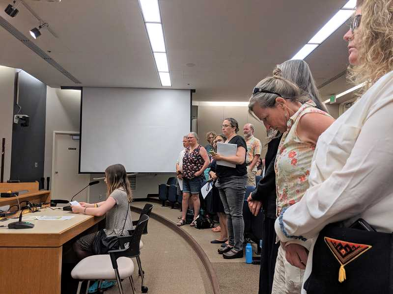 PMG PHOTO: COURTNEY VAUGHN - Morgan Kubler, a Portland Public Schools student, addresses the school board Aug. 13 during its review of a complaint related to talented and gifted programming. Behind Kubler, parents stand in support of demand for better resources for TAG students.