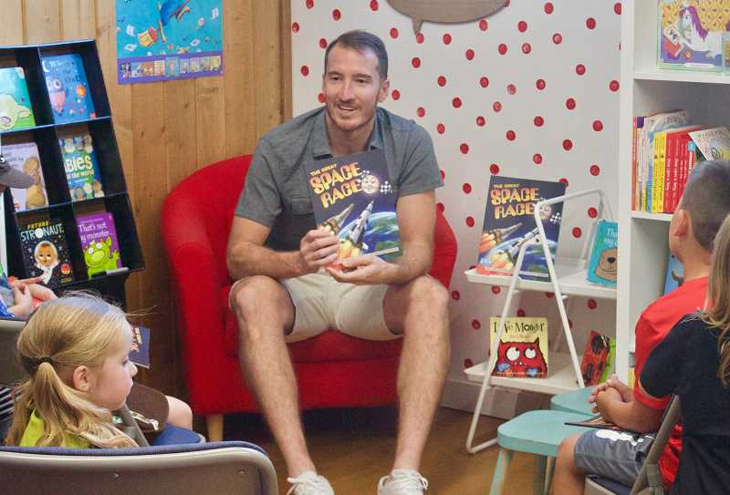 PMG PHOTO: CHRISTOPHER KEIZUR - Jeff Attinella was excited to share his latest book with Gresham children, many of whom wore Timbers gear.