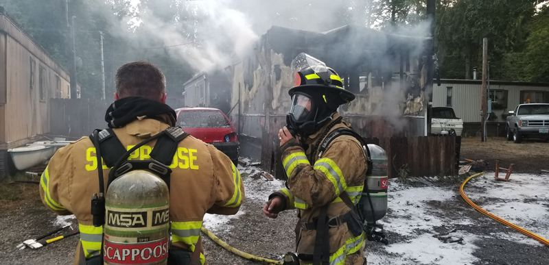 COURTESY PHOTO: SCAPPOOSE FIRE DISTRICT - Firefighters from Scappoose Fire and Rescue and Columbia River Fire and Rescue responded to a house fire in the 32800 block of Scappoose Vernonia Highway last week. The home was declared a total loss after the blaze.