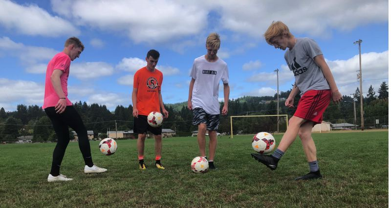 PMG PHOTO: STEVE BRANDON - Four Scappoose boys soccer mainstays work on their ball control at practice. From left: Brisyn Maller, DJ Backus, Jake Boyle and Teegan Bond.