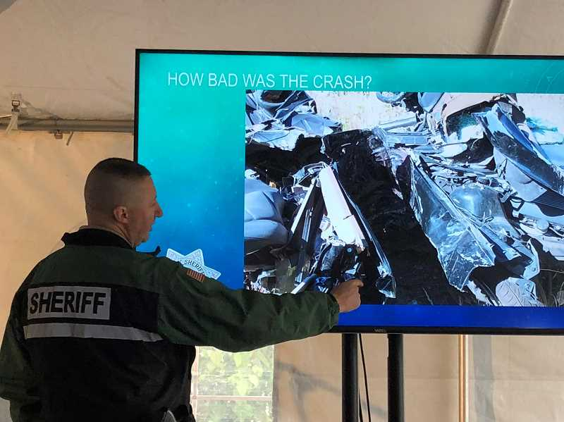 COURTESY PHOTO - Deputy Bryon O'Neil, crash reconstructionist for the Clackamas County Sheriff's Office, analyzes Maddi Higgins crash.