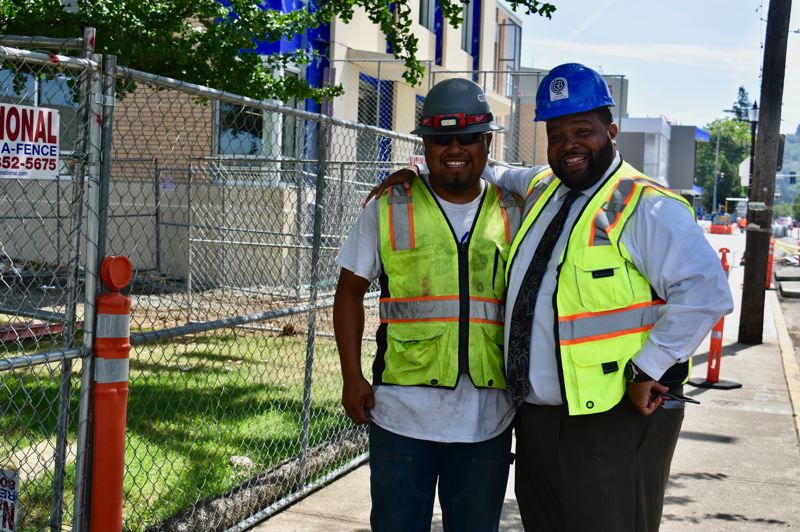 PMG PHOTO: TERESA CARSON - Kevin Leon, class of 2019, is working on the high school he graduated from only months earlier. Leon and Shelton struck up a conversation as the new principal walked around the construction site.