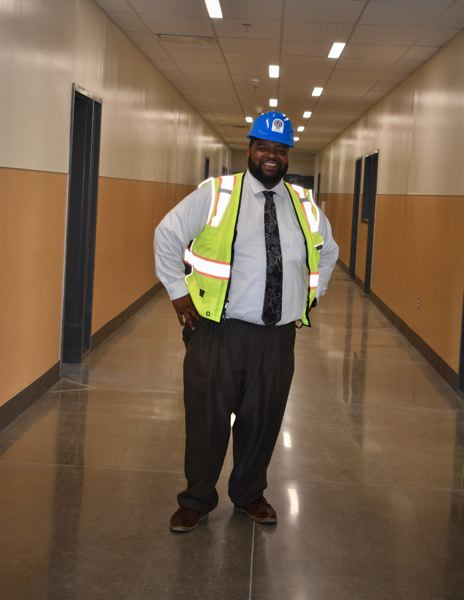 PMG PHOTO: TERESA CARSON - Gresham HIgh School principal Drake Shelton sizes up a hallway in the new high school days before students arrive.
