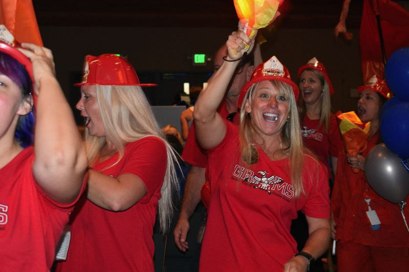 PMG PHOTO: TERESA CARSON - Gordon Russell Middle School staff were on fire at the 2019 Gresham-Barlow School District convocation. They even arrived at the event in a fire truck.