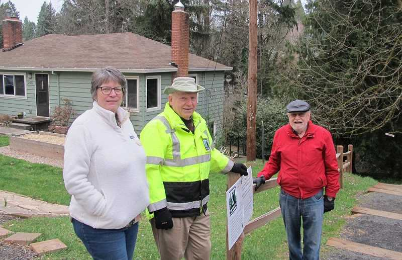 BILL GALLAGHER - Debbie Small(l), Don Baack (center) and Glenn Bridger(r) of SW Trails PDX along a segment of the still-unfinished Red Electric Trail near SW Beaverton Hillsdale Highway.