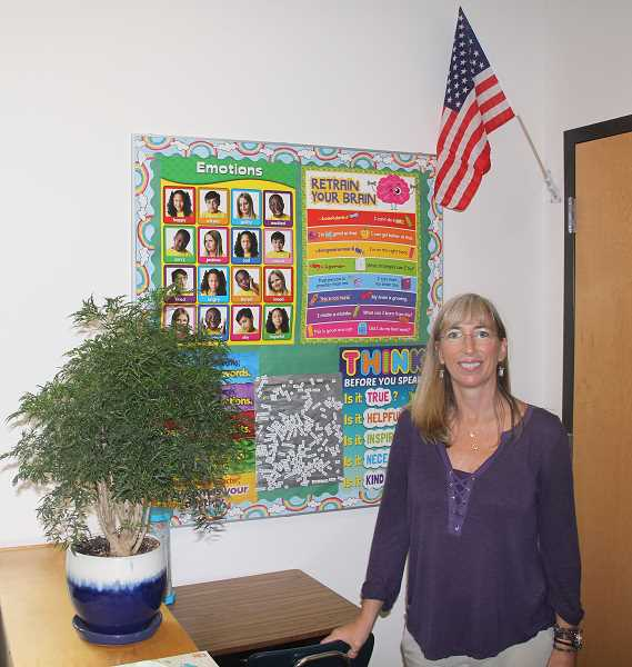 PMG PHOTO: JUSTIN MUCH - Washington Elementary School 5th-grade teacher Christy Bright keeps a lot of positive, mentally healthy messages posted around her classroom.