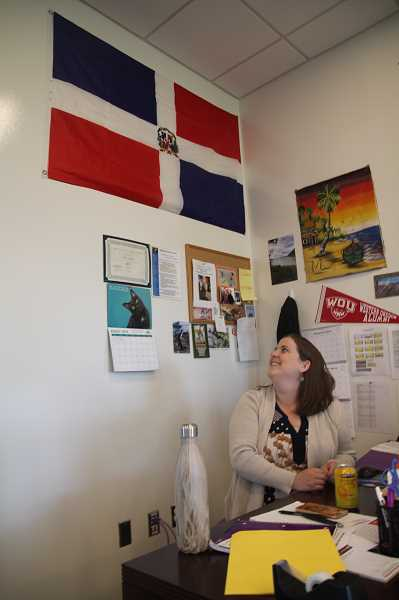 PMG PHOTO: JUSTIN MUCH - Success Alternative High School social studies teacher Stephanie Burns keeps a Dominican Republic flag on the wall behind her desk. She began her teaching careeer in that country where she spent three years teaching.