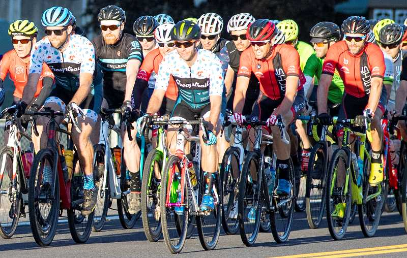 LON AUSTIN/CENTRAL OREGONIAN - Riders in the 80-mile race at the Ochoco Gravel Roubaix leave Prineville heading east early Saturday morning. Elias Lawson of Ashland edged out Aris Sophocies and Cody Peterson, both of Bend to win the race. All three riders finished with a time of 4:10:22.
