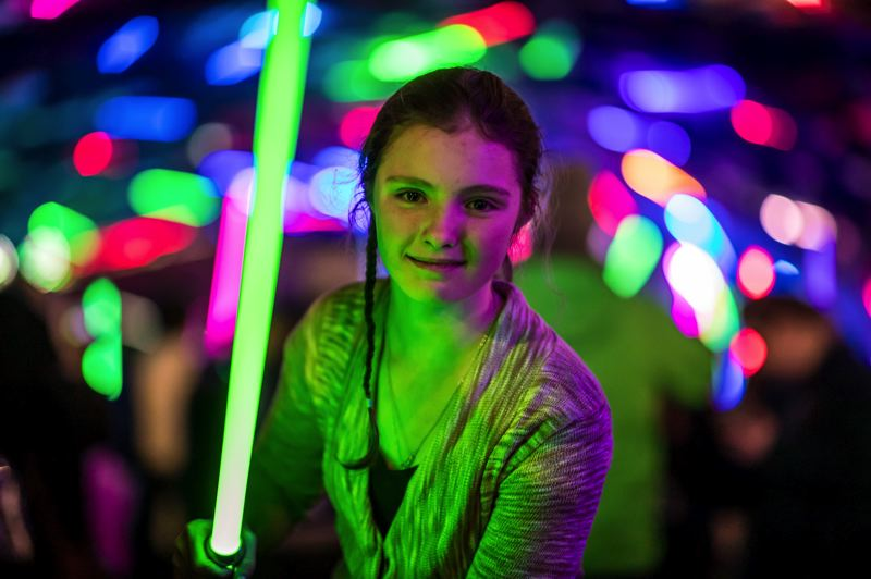 COURTESY PHOTO: STAR WARS CELEBRATION - Some people connect most to the space theme used for many summer reading activities this year through pop culture, as in the case of this young Star Wars fan with a prop lightsaber at the 2019 Star Wars Celebration in Chicago.
