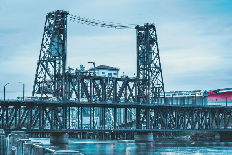 PMG FILE PHOTO - The Steel Bridge is a MAX bottleneck that has TriMet thinking about running light rail trains through tunnels under the city.