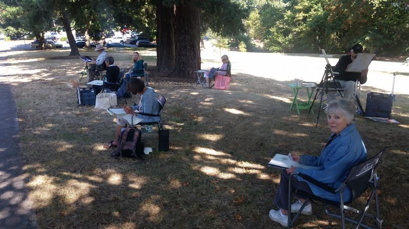 PMG PHOTO: RAYMOND RENDLEMAN - Susan Spears (right) leads a plein-air painting class through rendering a combination of trees and historic architecture during a recent visit to Barclay Park in Oregon City.