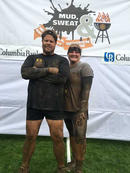 COURTESY OF WOODBURN ROTARY - Matt and Kim Geiger pose before and after taking part in the Mud, Sweat & BBQ run at Wooden Shoe Tuliup Farm on Aug. 9.