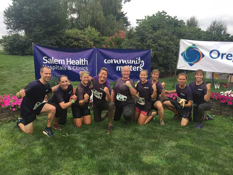 COURTESY OF WOODBURN ROTARY - Salem health team in front of their banner at the Mud, Sweat & BBQ run, Aug. 19.