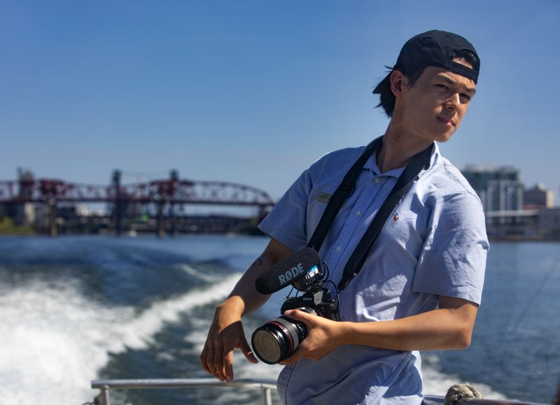 PMG PHOTO: JONATHAN HOUSE - Videographer Key Higdon looks for the next shot aboard a Frog Ferry tour.