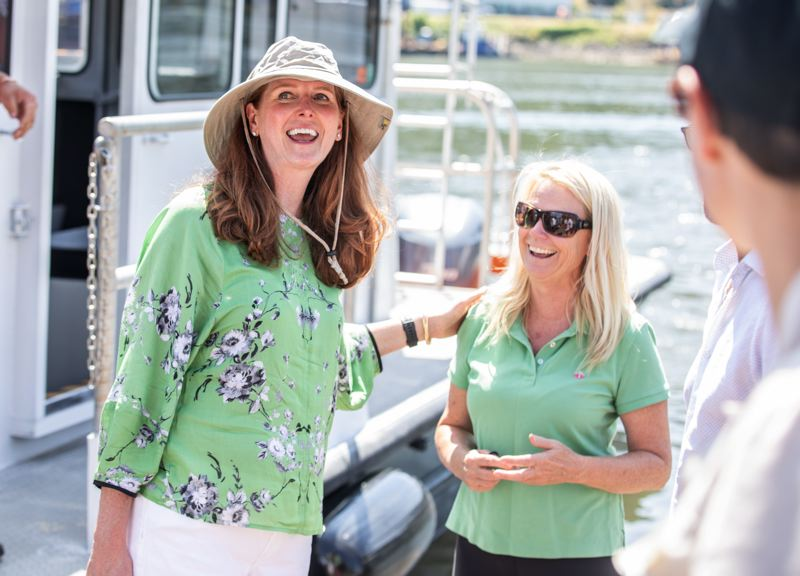 PMG PHOTO: JONATHAN HOUSE - Frog Ferry Founder Susan Bladholm speaks with supporters during a recent chartered tour of the Willamette River.