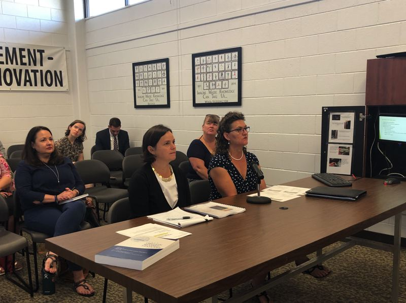 PMG PHOTO: ANNA DEL SAVIO - Amanda Lowthian, left, and Alison Hart, right, provide county commissioners an overview of the Columbia County Tourism Initiative's work at a commission meeting Aug. 28, 2019.