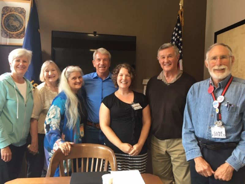 COURTESY PHOTO - Congressman Kurt Schrader (center) meets with Indivisible Clackamas members (from left) Terry Larson, Janine Settelmeyer, Mary Lyon, Amber Tatge, Michael Heyn and Gene Fifield.