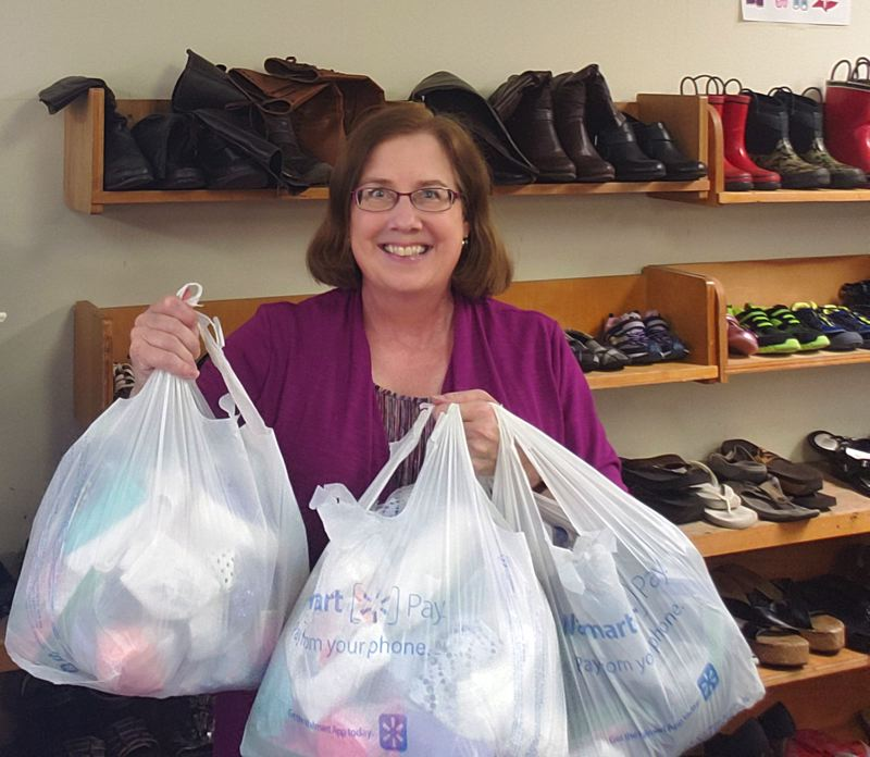 COURTESY PHOTO - Rotarian Leslie Robinette delivers donations to the Gladstone Clothes Closet as part of the club's $2,000 donation this fall.