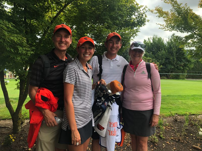 PMG PHOTO: STEVE BRANDON - Ellie Slama (second from left), with caddy/brother Tim and their parents, Doug and Leilani, are all smiles after her second-round 69 Friday at Columbia Edgewater Country Club in the LPGA Cambia Portland Classic.