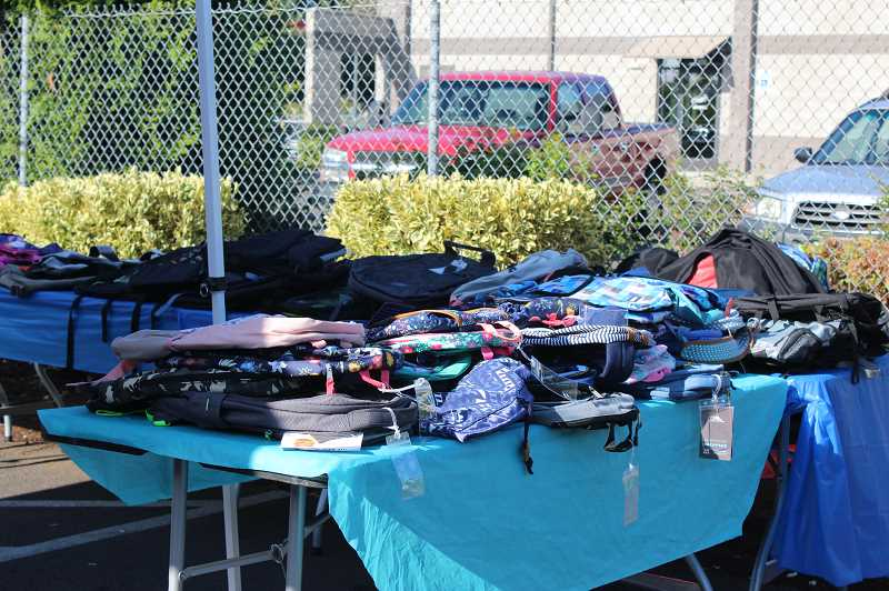 PMG PHOTO: KRISTEN WOHLERS - The Canby Center collected at least 350 backpacks for the event.