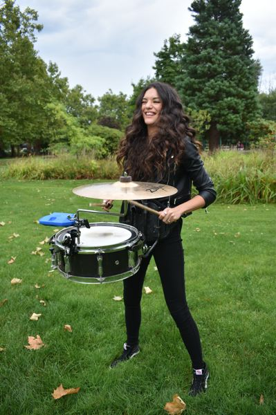 PMG PHOTO: SHANNON O. WELLS - Onstage or off, Gresham resident and March Fourth drummer/vocalist Camille Denny radiates joy and intensity when playing snare drum and cymbals, which she does here on a lark in downtown Gresham's Main City Park.