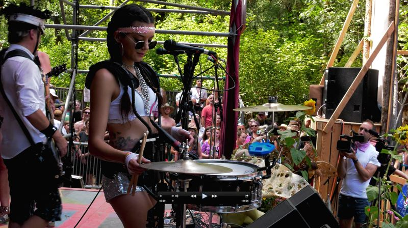 COURTESY PHOTO: DIGGABLE MONKEY  - Camille Denny, dressed for the occasion at the Oregon Country Fair last July, brings the house down when her high, impassioned vocals hit the mic with MarchFourth on songs like 'Serpentine Fire' and '25 or 6 to 4. '