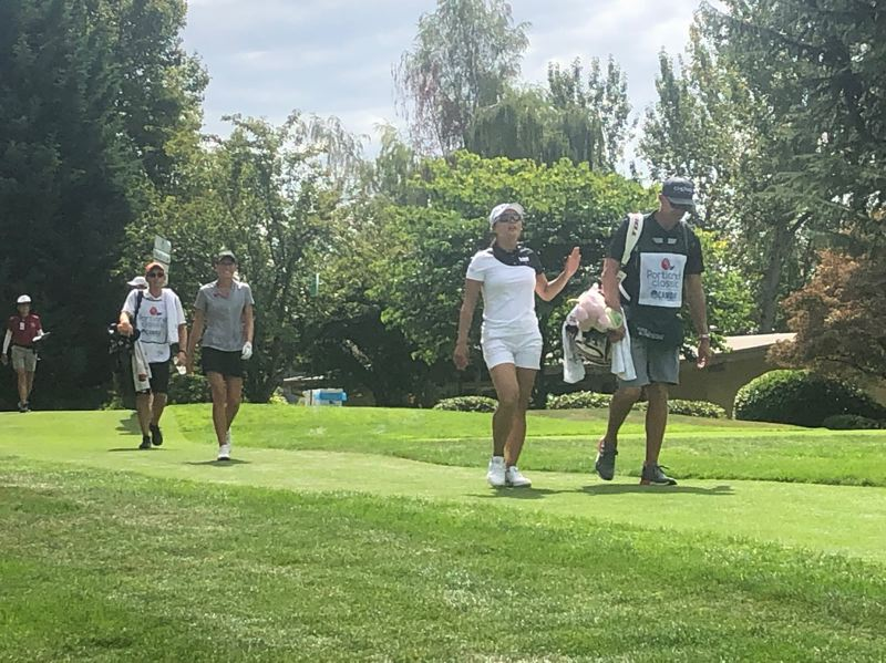 PMG PHOTO: STEVE BRANDON - World No. 1 Jin Young Ko leads Oregon State junior Ellie Slama off the tee during Saturday's third round of the LPGA Cambia Portland Classic at Columbia Edgewater Country Club.