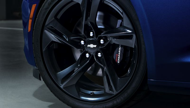 COURTESY CHEVY - The 2019 Camaro SS featyres 20-inch Carbon Flash pained five-spoke aluminum wheelers that show off the big disc brakes.