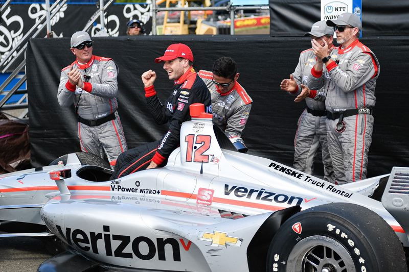 PMG PHOTO: CHRISTOPHER OERTELL - Will Power celebrates in the winner's circle on Sunday after capturing the NTT IndyCar Series Grand Prix of Portland at Portland International Raceway.