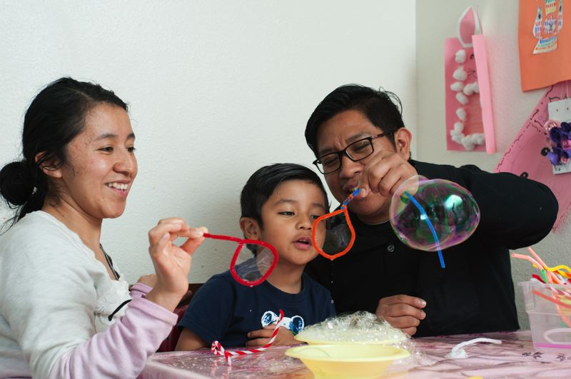 COURTESY PHOTO: HEAD START - This family tries out some bubble engineering as part of the Head Start on Engineering program.