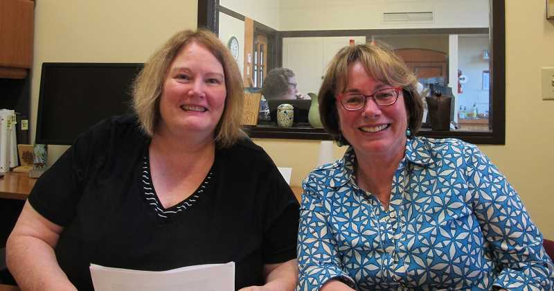 BILL GALLAGHER - GROUND ZERO - Sylvia Bogert (l), executive director, and Leslie Hammond (r), president of Southwest Neighbors Inc., in the district coalition's office in the Multnomah Arts Center.