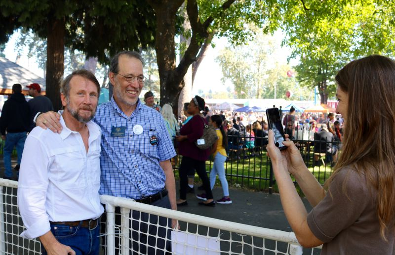 PMG PHOTO: ZANE SPARLING - State Sen. Michael Dembrow, D-Portland, at center, poses for a photo during the 2019 Labor Day picnic. He attended despite being banned from giving a speech at the annual event.