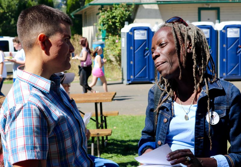 PMG PHOTO: ZANE SPARLING - Portland Commissioner Jo Ann Hardesty meets with union carpenter Shannon, left, during the Northwest Labor Council's 2019 Labor Day Picnic on Monday, Sept. 2 at Oaks Amusement Park.