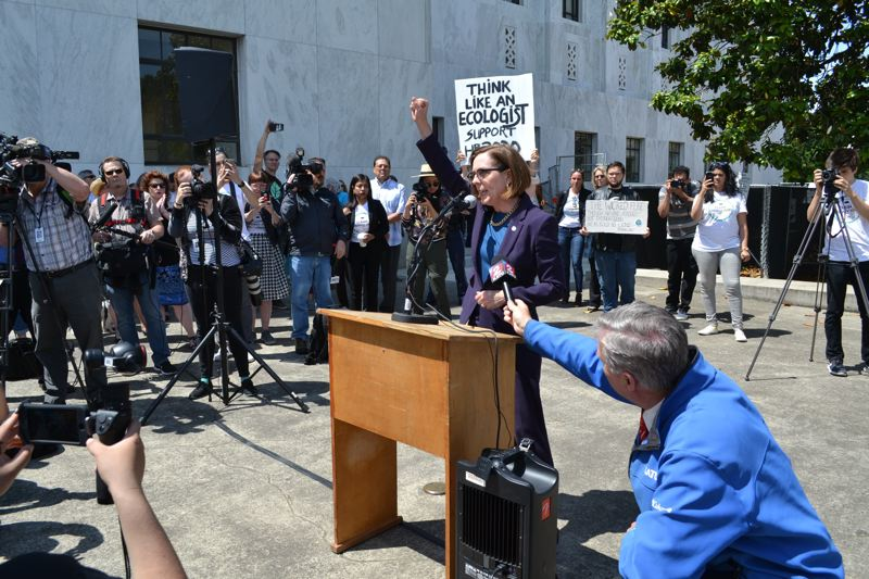 PMG FILE PHOTO - Gov. Kate Brown, pictured leading a rally outside the Oregon State Capitol in June, plans to call the Legislature back into session this fall.