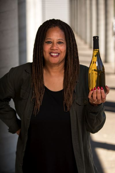 PMG PHOTO: JAIME VALDEZ - Donna Stoney holds up a bottle of wine. She's preparing for the launch party of Stoney Wines, Oregon's first winery owned by a black woman, on Saturday, Sept. 7.