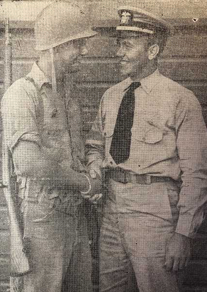 CENTRAL OREGONIAN - AUGUST 31, 1944 – REUNION IN HAWAII: These two Prineville men, Donald S. Yancey, machinist mate third class in the Seabees and Ensign Robert O. Yancey, navy air corps, hadn't seen each other for quite a while when this picture was taken in Hawaii. They followed far different courses of training in the navy, but both happened to be stationed in the Hawaiians and a meeting was arranged. Since this picture was taken, Ensign Yancey has been rescued after a parachute landing at sea when his plane went out of control. He is reported recovering from injuries suffered in the incident, according to word received by the parents of the two boys, Mr. and Mrs. Orville Yancey.