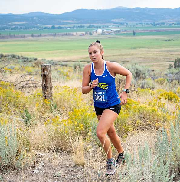 LON AUSTIN/CENTRAL OREGONIAN - Jan Carne climbs a hill during the Jere Breese Memorial Ranch Stampede, which took place Thursday morning. Carne finished in fifth place in the girls race with a time of 22:57.82.